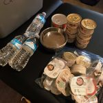canned cat food, food dishes, and water