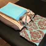 fleece blanket, towels, and a storage bag
